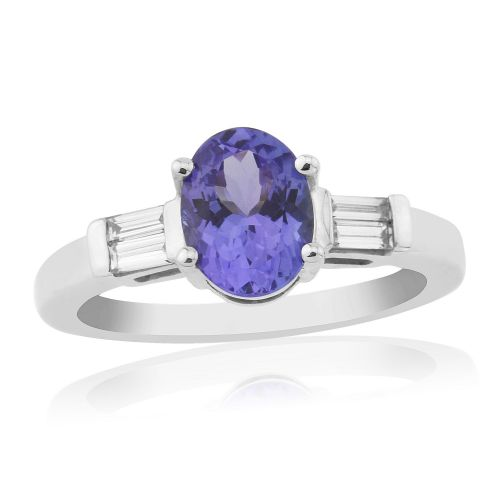 White gold oval cut tanzanite and diamond trilogy ring